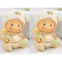 Neonata con bambola con confetti e bigliettino