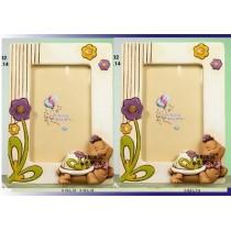 Portafoto tartaruga allegra femmina in scatola regalo con confetti e bigliettino